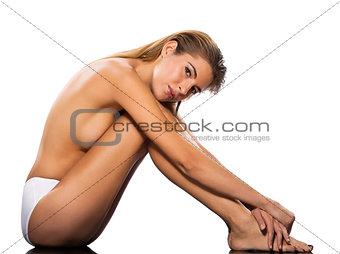 beautiful topless caucasian woman sitting full length