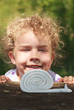 Smiling little girl with lovely curly blond hair