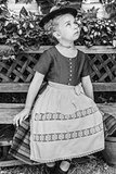 Black and white portrait of a girl in a dirndl