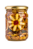 Glass jar filled with honey, nuts and fruits