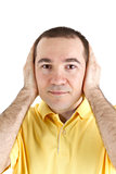 man covers his ears with his hands