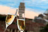 Two glasses of champagne with the Tower of Pisa in the backgroun