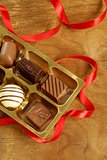 gift box of chocolate candies on a wooden background
