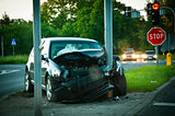 wrecked car after hitting a lamp post