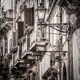 Beautiful vintage balconies and street lamp in old mediterranean