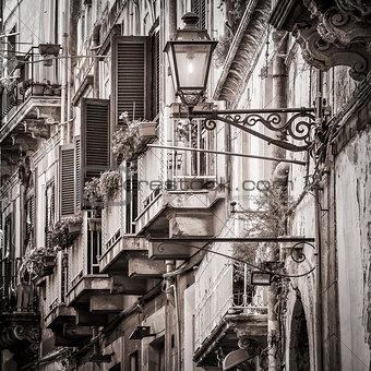 Beautiful vintage balconies and street lamp in old mediterranean