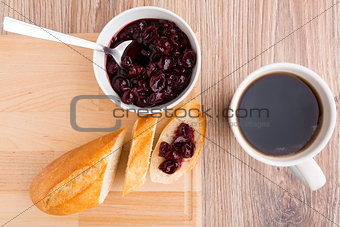 Slice of baguette with cherry jam