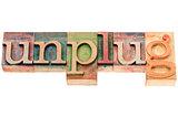unplug word in wood type