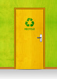wooden door with recycle sign