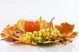 Glass of wine with grapes and leaves