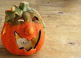 Halloween pumpkin Jack O'Lantern on a wooden background