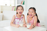 Children drinking milk.