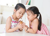 Children eating ice cream cone