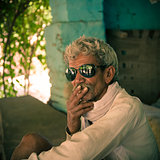 Smoking by old indian villager
