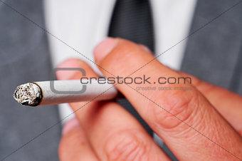 man in suit smoking