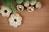 walnuts and gingerbread on wooden background