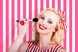 Smiling makeup girl using cosmetic powder brush