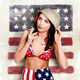 USA pin-up woman. On vintage American flag wall