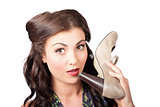 Pinup vintage woman chatting on shoe phone