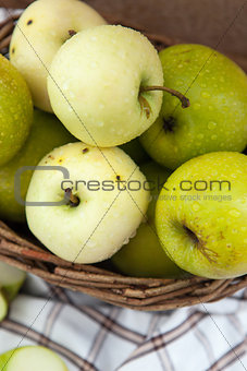Fresh apples in a basket