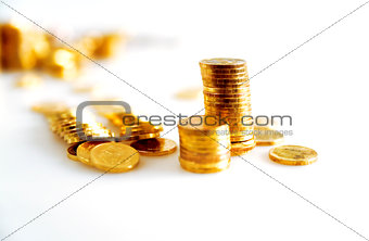 bright golden coins on white background