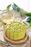 Green tea with red bean paste mooncake