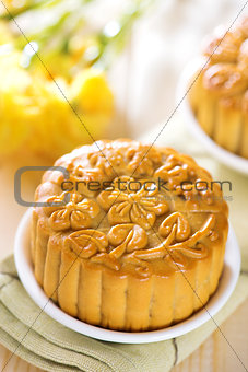 Assorted fruits nuts mooncakes on table