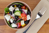 fresh greek salad in clay bowl