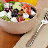 fresh greek salad in clay bowl