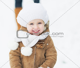 Portrait of happy baby in winter park