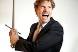 Crazy businessman attacking with a sword