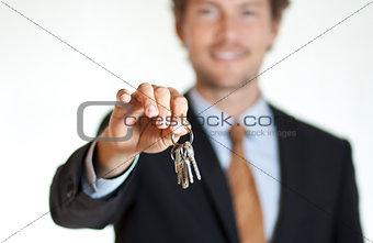 Smiling businessman handing keys