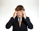 Suffering businessman with migraine