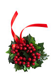Christmas berries wreath with red ribbon