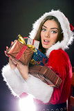 Santa girl with Christmas gifts.