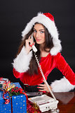 Santa girl answering the phone