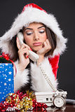 Unhappy Santa girl on the phone