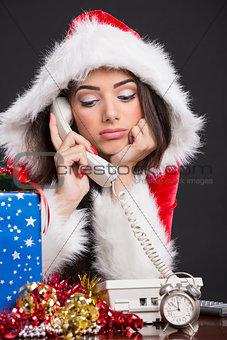 Unhappy Santa girl on the phone