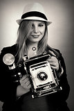 Beautiful female retro photographer