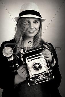 Beautiful female retro photographer