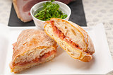 ciabatta panini sandwich with parma ham and tomato