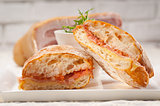 ciabatta panini sandwich with parma ham and tomato