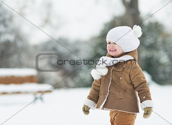 Portrait of smiling baby in winter park