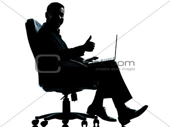one business man computer computing thumb up sitting in armchair
