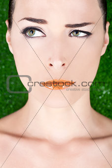 Beautiful angry woman with glossy lips looking away