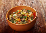 boiled pearl barley with meat and vegetable