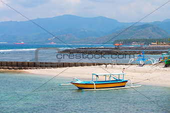 Traditional Balinese boat on a beach