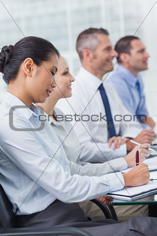 Cheerful employees attending presentation