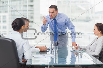 Angry executive pointing out his employee