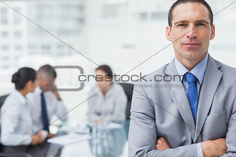 Serious businessman posing with